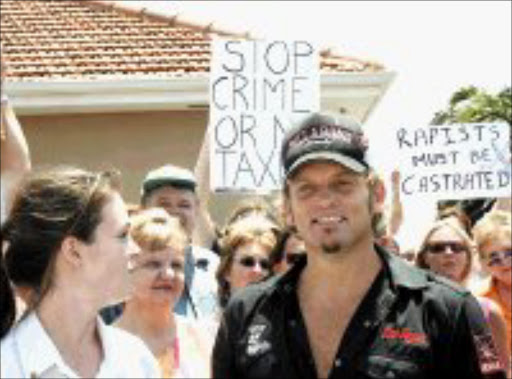 ON BANDWAGON: Steve Hofmeyr with a group of protesters at a recent demonstration. Pic: Giordano Stolley. 23/01/2007. © SAPA.  HAD ENOUGH: Afrikaans star Steve Hofmeyr with protestor outside the Scottburgh magistrate's court, where three men appeared in connection with the rape of three holidaymakers in Pannington, near Scottburgh.