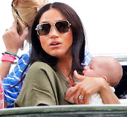The Duchess of Sussex and baby Archie at a charity polo match in Wokingham, England, on July 10 2019..