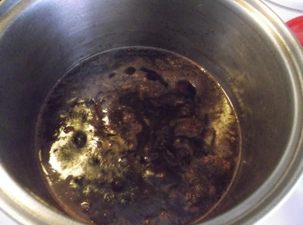 Add the ribs and any juices back to the pot along with the stock....