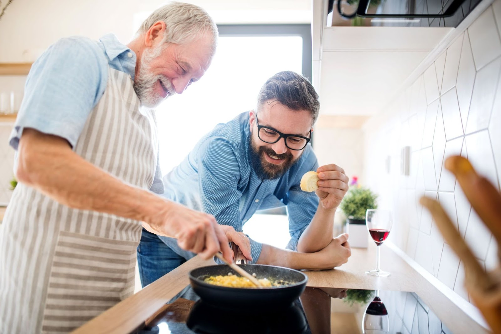 senior-father-cooking-with-adult-son
