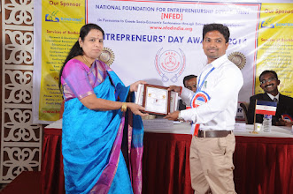 Photo: Chief Guest Dr. V. Padmavathy Issuing Young Entrepreneur Award to Mr. Saravanakumar. V., Co-Founder & CEO, Bonfirng, Coimbatore