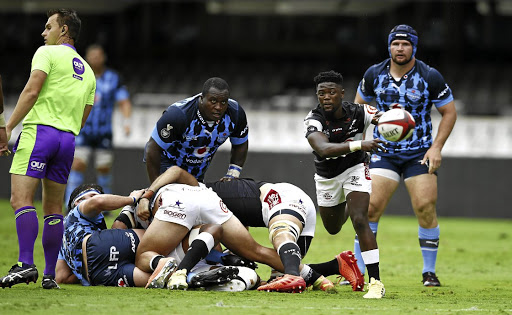 Sanele Nohamba of the Sharks picks up and passes the ball during yesterday's hard fought tie against the Blue Bulls.