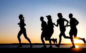 A group of people running .