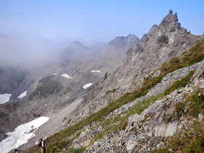 Photo: Rick stands on the talus beneath the ridgeline. Our peak is off camera to the right.