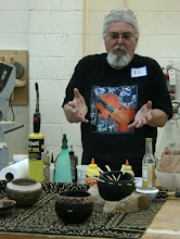 Photo: Ed discusses decorating woodturnings in terms of his bogolon and decorative traditions in Mali