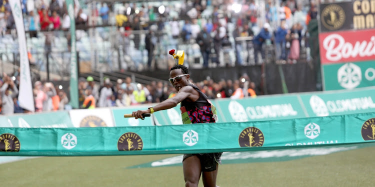 Comrades Marathon winner Bongmusa Mthembu crosses the finish line on June 10, 2018.