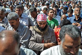 Photo: The mass prayer in Tahrir Square begins.
