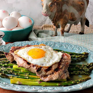 Buttery Rich Keto Steak and Eggs Over Asparagus.