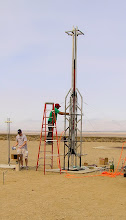 Photo: Two stage hybrid/solid rocket mounted in a scaffold style rail by the Stanford student team.
