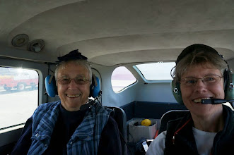 Photo: Mary Kay and Diane on board. The plane is noisy, so the headsets let us communicate with the pilots.