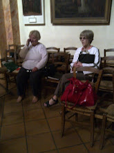 Photo: Vivienne Vincent and Kathy Trant resting their feet before rehearsing in St. Trophyme Church, Bormes