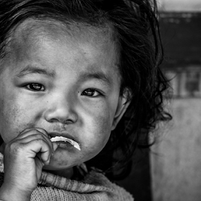 Innocence by Subhajit Basak - Black & White Portraits & People ( face, monochrome, black and white, children candids, indian, children, child portrait, child photography, candid, people, bengal, close up, portrait, eyes, child, girl, child portraits, innocence, childhood )