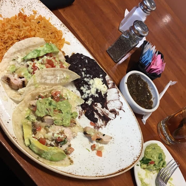 Very tasty and a huge portion. 3 soft shell chicken and avocado tacos, amazing black beans and rice. I ordered guacamole on the side. Enough food for 2! I'm very sensitive to gluten and did not react