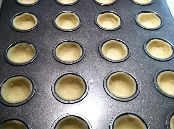 Divide dough into 1-inch balls (rounded teaspoonfuls); press the dough over the bottom and...