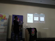 Busisiwe Nkosi of the Ahmed Kathrada Foundation explains on Tuesday how the public can use the Zimele Racism Reporting App (ZiRRA) to learn about and report racism-related incidents.