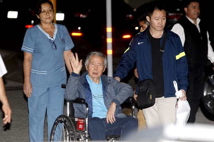 Former Peruvian President Alberto Fujimori accompanied by his son Kenji Fujimori leaves the Centenary hospital in Lima, Peru, January 4 2018. Picture: REUTERS