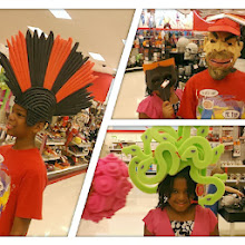 Photo: Q and Kaleya playing around with Halloween costumes in Target