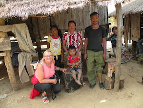 Photo: AMFW Lisa McCoy with Landmine Survivor Un Prum and family
