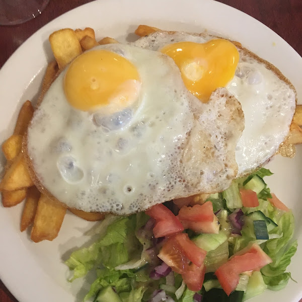 Eggs on Chips and Salad