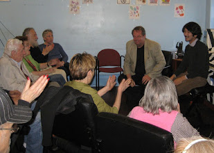 Photo: Cafe host Gary Glazner, of the Alzheimer's Poetry Project, introduced Jae.