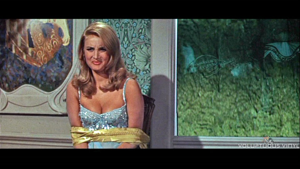 Barbara Bouchet as Moneypenny, tied up in Casino Royale