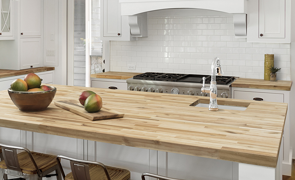 A kitchen with butcher block countertops.