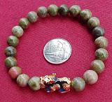 2#หินยูนาไคต์ (Unakite)หรือที่คนไทยเรียกหินถูกหวย สวยมากๆๆงามสุดๆ**สุดยอด 1 เดียว 5 มิล.หายาก ของแท้ครับ +ปี่เซียะเปลี่ยนสีตามอุณหภูมิ ของแท้ นานๆมาที ที่อื่นพันกว่าครับวัดใจ 10 บาท สร้อยข้อมือหินยูนาไคต์ ร้อยด้วยเอนยางยืดใส่สบายได้ทั้งชายและหญิง สวยงาม