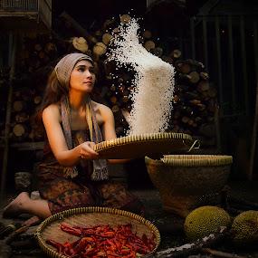 nampin Beras by Doeh Namaku - People Portraits of Women
