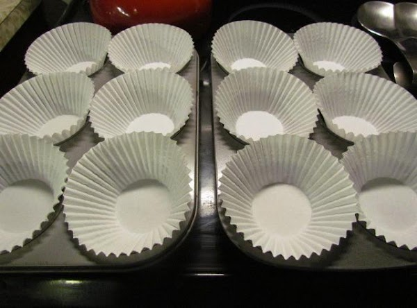 Preheat your oven at 350 degrees  prepare two large cupcake pans using cupcake papers (or...