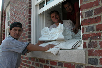 Photo: August 2006 - Month 36: Building the porch. Handing the first capital out the window. Zenom, Joe and Leo (in shadow)