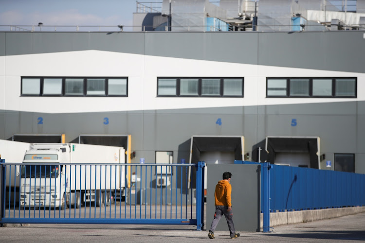 A man walks outside the Catalent plant where millions of doses of the AstraZeneca vaccine were found, in Anagni, Italy, March 24 2021. Picture: REUTERS/YARA NARDI