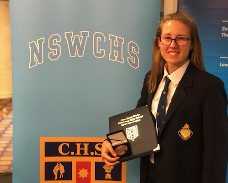 Bella Stewart receives her NSW Combined High Schools Sports Association blue award on Friday, November 30, at ANZ Stadium in Sydney.