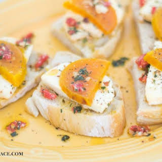 Roasted Golden Beet Marinated Mozzarella Herb Crostini.