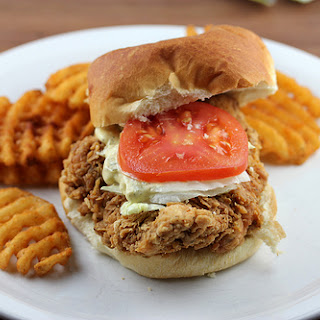 Homemade Fried Chicken Sandwiches with Dill Pickle Sauce.