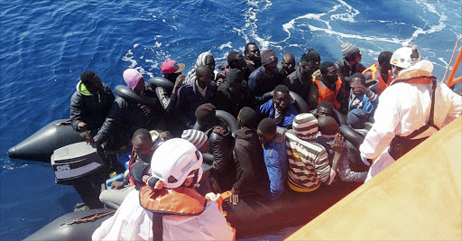 A handout picture provided by Sea Rescue of the thirty migrants who have been rescued when they sailed on a small canoe near Motril Coast in Granada, southern Spain, 31 May 2016.