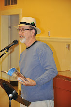 Photo: Michael Schein reads his poetry.