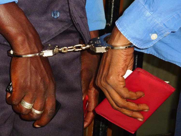 Suspects handcuffed./FILE