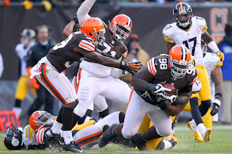 Photo: Cleveland Browns defensive tackle Phillip Taylor recovers a fumble from Pittsburgh Steelers running back Chris Rainey in the fourth quarter Sunday, November 25, 2012 at Cleveland Browns Stadium in Cleveland.  The Browns won the game 20-14. (Joshua Gunter/ The Plain Dealer)