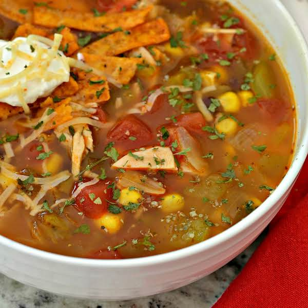 Chicken Enchilada Soup Combines Onions, Peppers, Black Beans, Corn, Diced Tomatoes, Green Chiles, And Chicken In A Perfectly Seasoned Chicken Broth.  This Easy Soup Comes Together Quickly With Ready Baked Scrumptious Rotisserie Chicken.