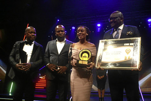 Overall winner of the Gauteng Township Entrepreneur Awards Nokubonga Dlamini is presented with the award at the event at Carnival City on Saturday night. Everyone who was nominated went home with R20000. / KABELO MOKOENA