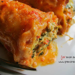 Spinach Lasagna Rolls With Roasted Red Bell Pepper Alfredo Sauce.