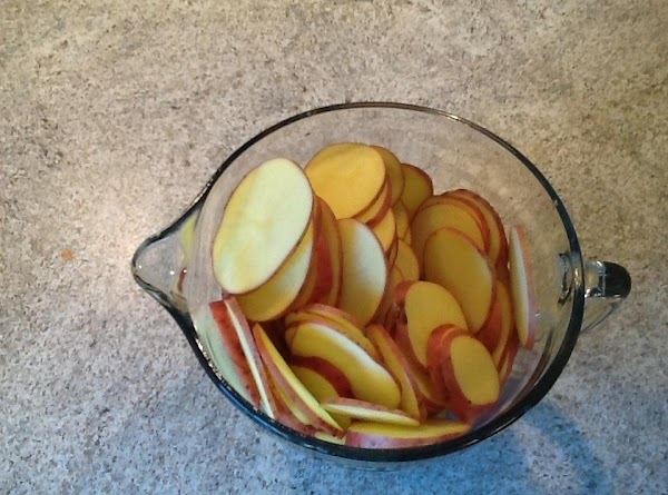 Clean and slice potatoes about 1/4 inch wide.  Rinse them again.