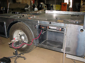 """Photo: The bottom skirting trim you saw on the other side of the truck is not on this side yet. You can see the fairing bracket below the forward part of the body. This is the location of the old steps. The box on the side of the bed by the tire is the wireless remote """"control"""" box with an on/off switch. The remote itself is on the deck just above the tire."""