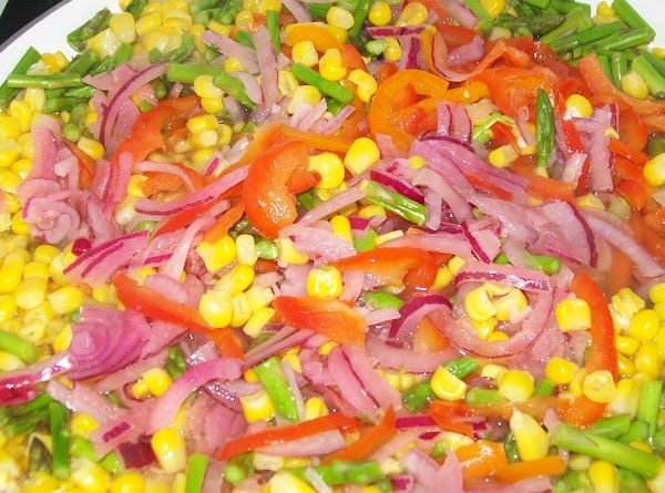 While that is cooking drain the vegetables and chop the pickled onions and peppers...