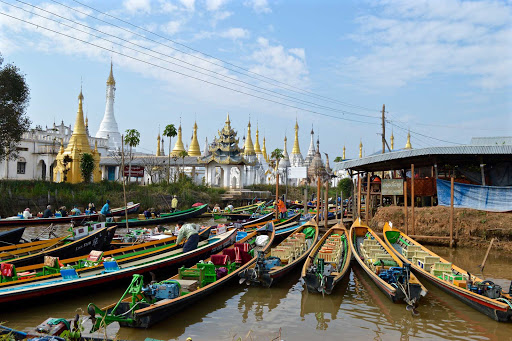 boats - Every day we spent around Inle Lake, we would hop into a flat-bottom wooden boat with a guide and a driver and cruise along the lake for 5-7 hours, in and out of communities, floating gardens, taking in fisherman, pagodas, etc.