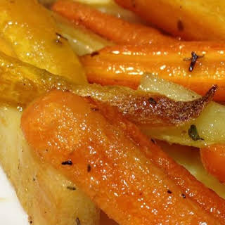 Roasted Sweet Potatoes and Vegetables With Thyme and Maple Syrup.
