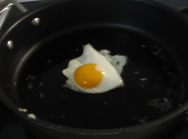 Fry one or two fresh eggs to desired taste, place on top of toast,...
