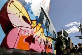 Photo: Adidas sponsors a group of international graffiti artists to paint the sides of a subway car replica on the corner of Lafayette and Broadway.  German artist Atom.   Original Filename: _G3F2451.JPG