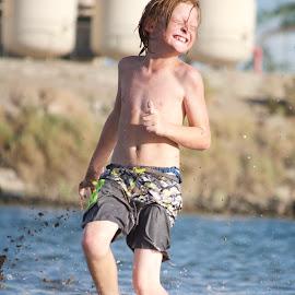 Terrorist by Savannah Eubanks - Babies & Children Children Candids ( running, redhead, playing, river, water, splash, boy, child )