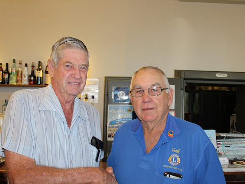 Ron Boxsell is congratulated by Boggabri Lions Club president Geoff Eather after being named Boggabri Senior Citizen of the Year yesterday.